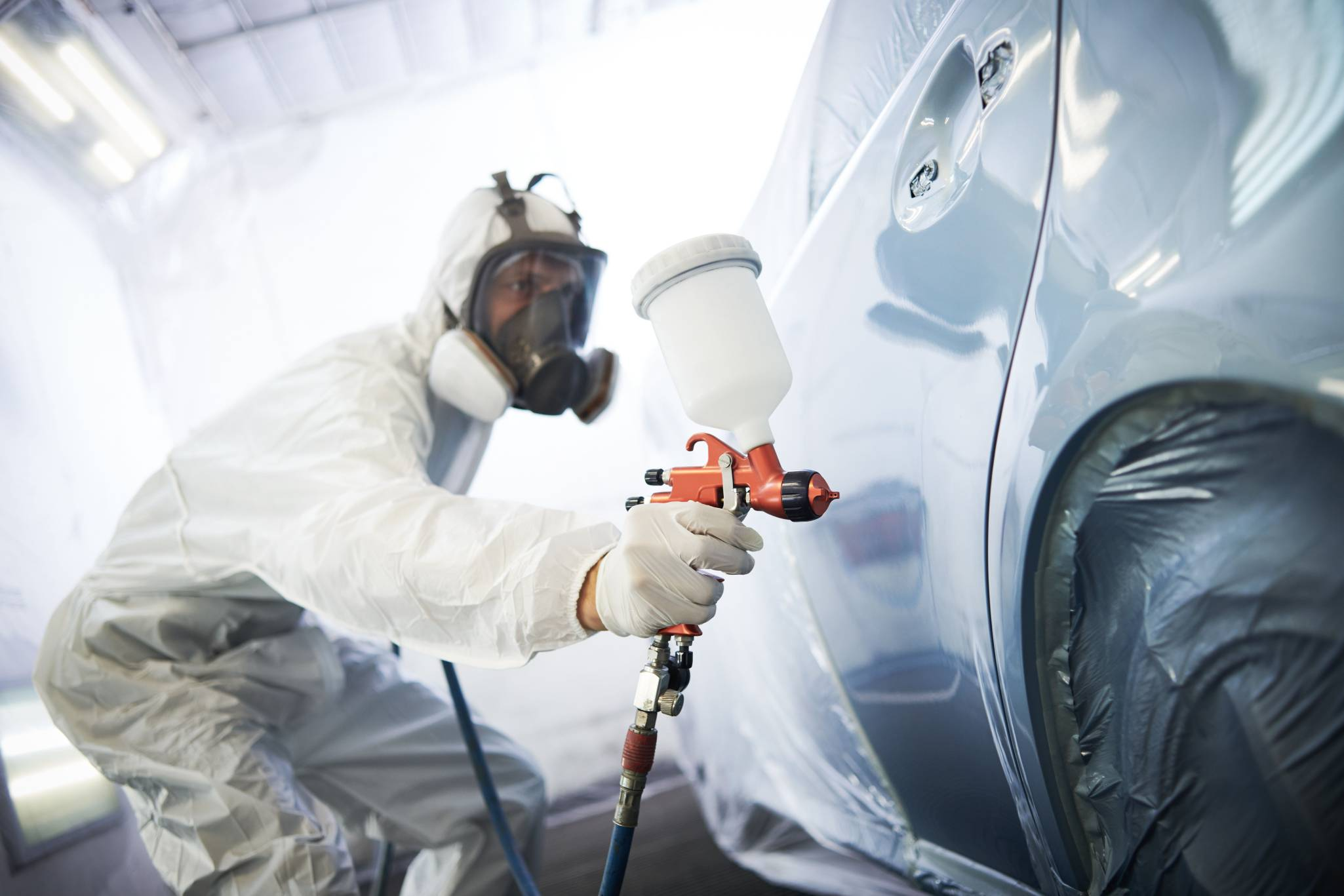auto body being spray painted